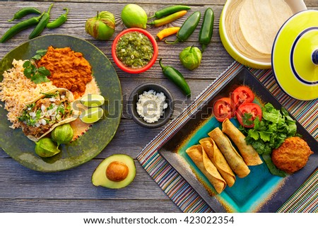 Mexican carnitas tacos with flautas from Mexico food ingredients - stock photo