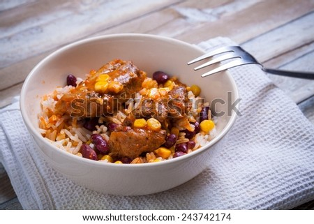 Mexican chicken bites with rice - stock photo