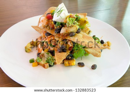 Mexican Chicken Salad with crispy tortilla avocado black beans spiced ...