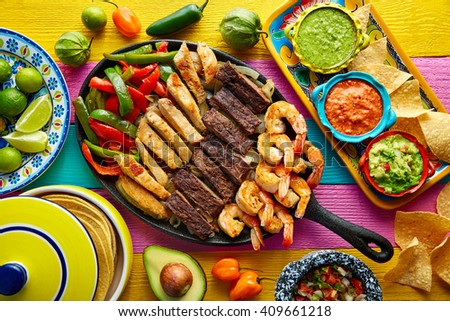 Mexican combo beef and chicken fajitas with shrimp - stock photo