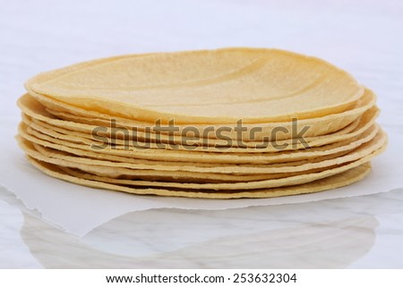 Mexican corn tortillas on retro vintage carrara marble, perfect for all your Mexican and tex-mex recipes. - stock photo