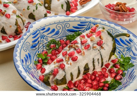 Mexican cuisine - Chiles en nogada - stock photo