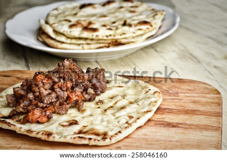 Mexican cuisine. Fried tortilla with meat. Cooking processes. Toned - stock photo
