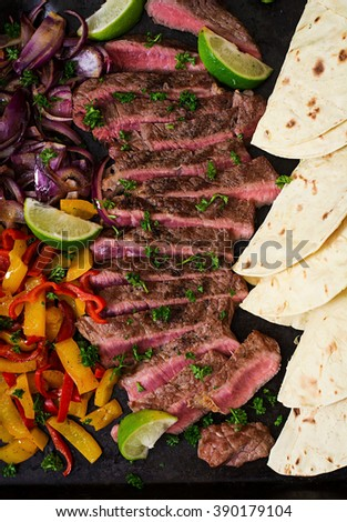 Mexican fajitas for beef steak and grilled vegetables. Top view - stock photo