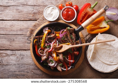 Mexican fajitas on a table in a rustic style. horizontal view from above