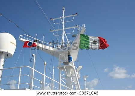 Mexican flag flying over a ship - stock photo