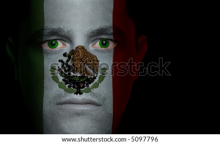 Mexican flag painted/projected onto a man's face.