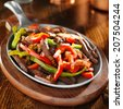 mexican food - beef fajitas and bell peppers - stock photo