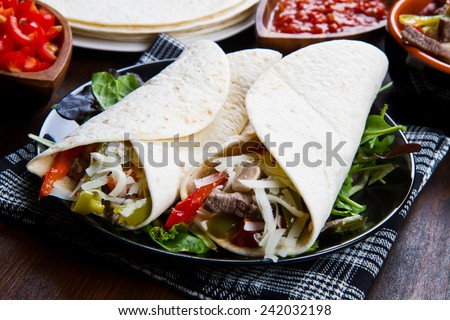 mexican food:  Chicken and Beef Fajitas with Vegetables and Tortillas  - stock photo