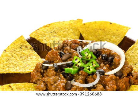 Mexican food: chili with meat served with nachos