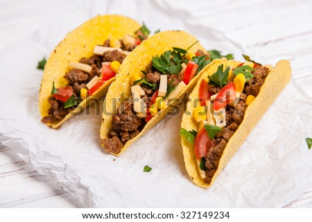 Mexican food - delicious tacos with ground beef - stock photo