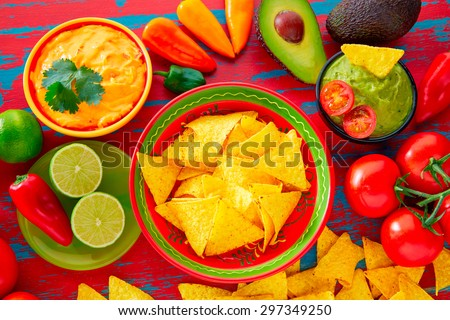 Mexican food nachos and guacamole with chili peppers and sauces - stock photo
