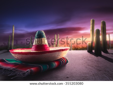 """Mexican hat """"sombrero"""" on a """"serape"""" in a mexican desert at night - stock photo"""