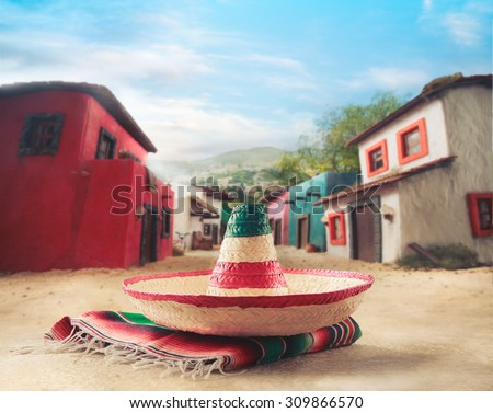 "Mexican hat ""sombrero"" on a ""serape"" in a mexican town - stock photo"