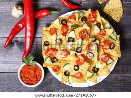 Mexican hot nachos with vegetables and chili