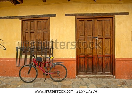 Mexican house with a bike in the front in San Cristobal de la Casas - stock photo
