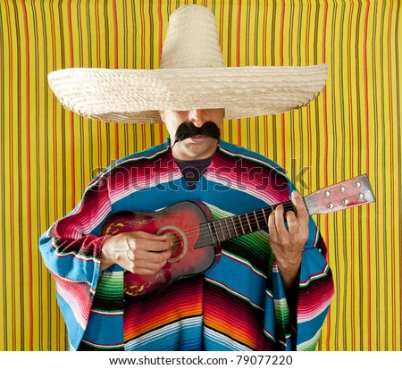 Mexican man serape poncho sombrero playing guitar typical Mexico - stock photo