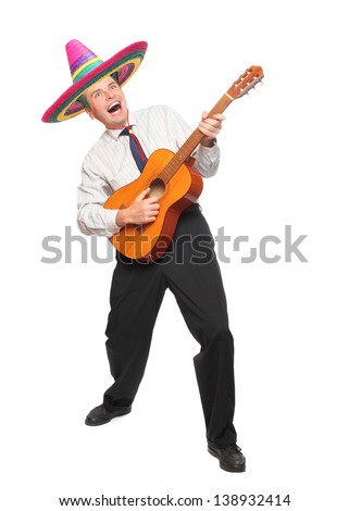 Mexican musician with guitar and sombrero singing.