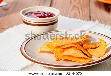 Mexican Nachos and sauce on a plate