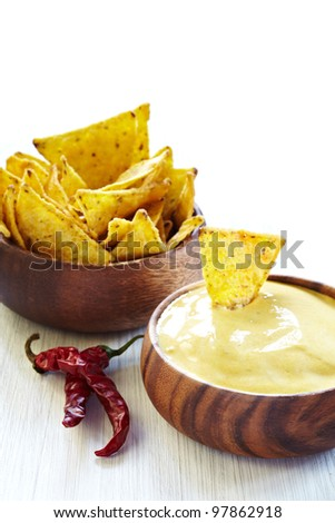 Mexican nachos, Cheese Sauce and Chili pepper - stock photo