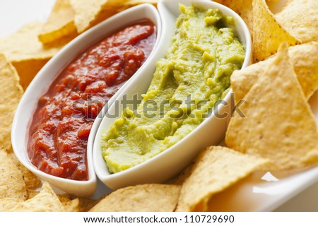 Mexican nachos. Homemade mexican salsas with corn chips - stock photo