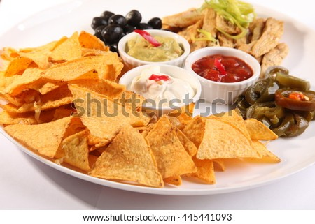 mexican nachos with tomato and olives