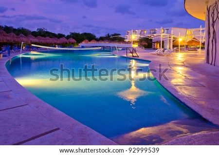 Mexican resort swimming pool at night. - stock photo