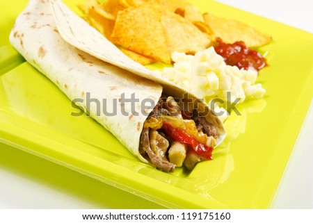 Mexican set with rolled tortilla and nachos - stock photo