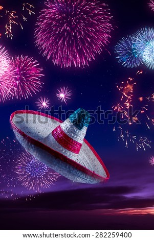 Mexican sombrero with fireworks at night - stock photo