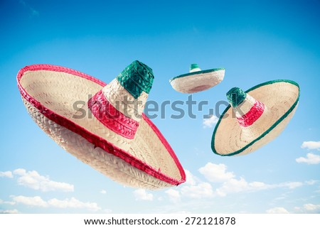 Mexican sombreros in a blue sky - stock photo