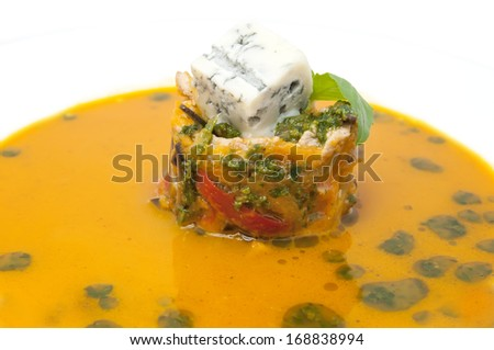 Mexican soup with vegetables and cheese in a restaurant - stock photo