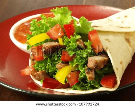 Mexican specialities: nachos, tomato dip and tortilla - stock photo