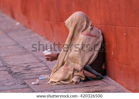 mexican street beggar woman with head covered