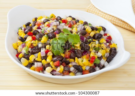Mexican style salad of black beans and corn, with a dressing flavoured with toasted cumin. Delicious with chilli!