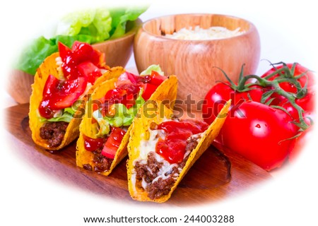 Mexican tacos in tortilla shells with fresh vegetables - stock photo