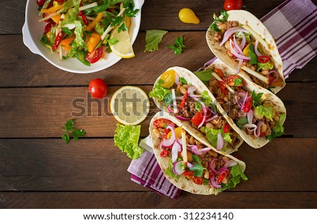 Mexican tacos with meat, beans and salsa. Top view