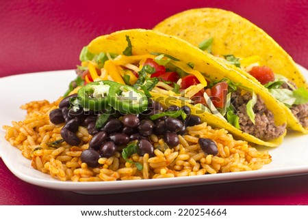 Mexican tacos with rice, black beans, and jalapenos - stock photo