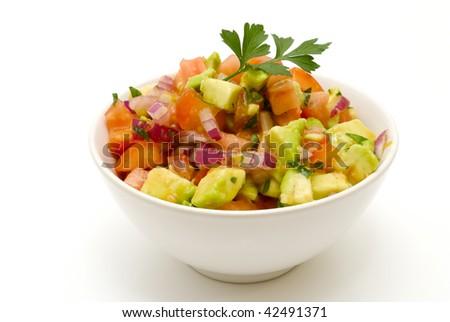 Mexican tomato salsa on white - stock photo