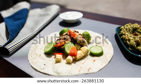 Mexican tortilla with chocken and guacamole - stock photo