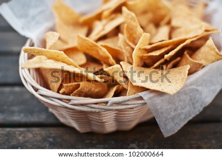 Mexican traditional chips nachos in basket - stock photo