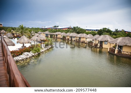 mexican vacation on the white beach and blue sea - stock photo