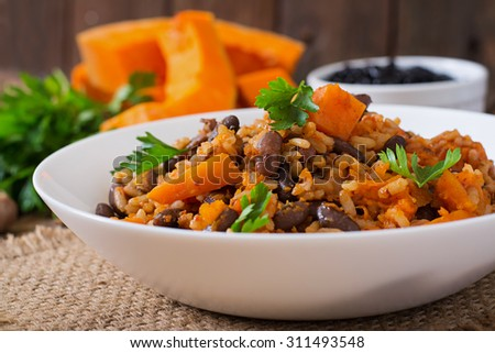 Mexican vegan vegetable pilaf with haricot beans and pumpkin - stock photo