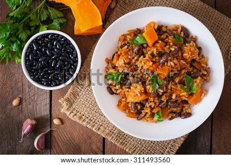 Mexican vegan vegetable pilaf with haricot beans and pumpkin. Top view - stock photo