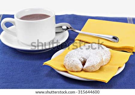 Mexican wedding cookies with a cup of hot cocoa. - stock photo