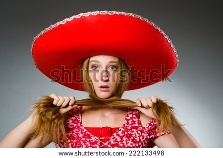 Mexican woman wearing red sombrero - stock photo
