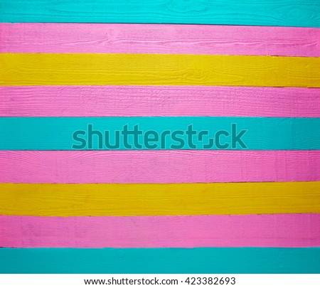 Mexican wood background colorful pink yellow and turquoise