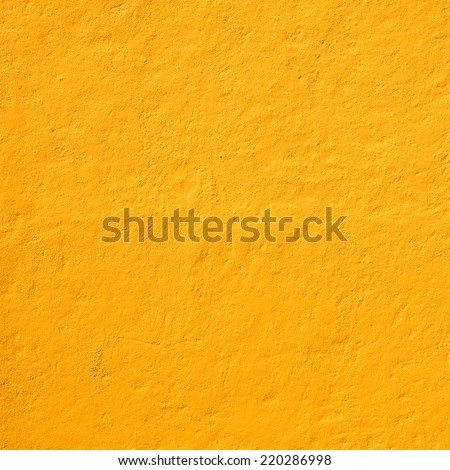 Mexican yellow rough wall for background - stock photo
