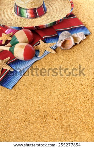 Mexico beach background : Mexican beach background with sombrero straw hat, traditional serape blanket, starfish, seashells and maracas.  Space for copy in sand.   Vertical format. - stock photo