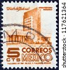 MEXICO - CIRCA 1950: A stamp printed in Mexico shows modern building, Mexico City, circa 1950. - stock photo
