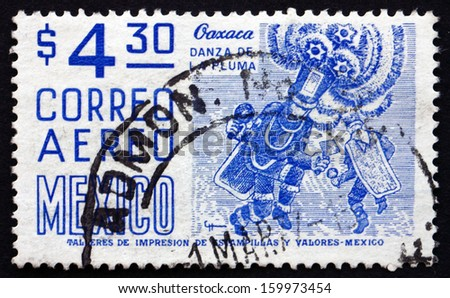 MEXICO - CIRCA 1975: a stamp printed in the Mexico shows Oaxaca, Danza de la Pluma, Re-enactment of the Battles between the Spanish and the Aztecs, circa 1975 - stock photo